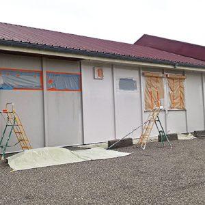 Remise en peinture du bardage d'une Salle des fêtes